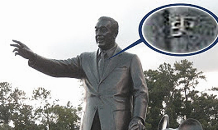 Walt Disney's tie pin in the Magic Kingdom Partners statue contains Smoke Tree Ranch logo