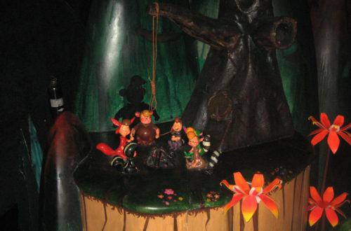 Peter Pan's Lost Boys cast fake shadows at Hangman's Tree in Peter Pan's Flight
