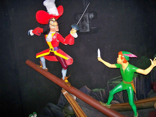 Disneyland's version of Peter Pan's Flight shows Captain Hook dueling with sword in left hand. Captain Hook's hook is on the right.
