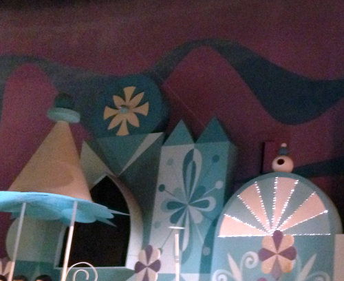 low tech special effects allow the cyclist to ride across a wire in it's a small world