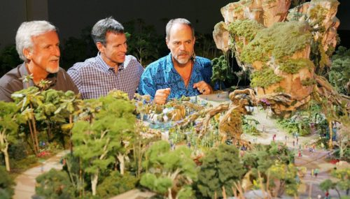 James Cameron, Tom Staggs, and Joe Rohde study the Pandora model