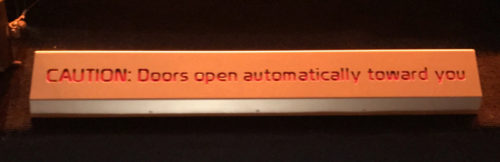 Doors Open Automatically Toward You sign at Disney World