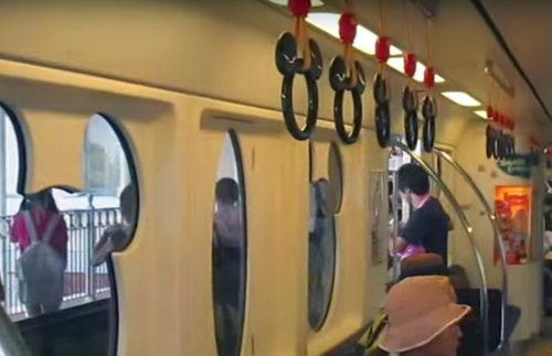 Tokyo Disney monorail Mickey handholds