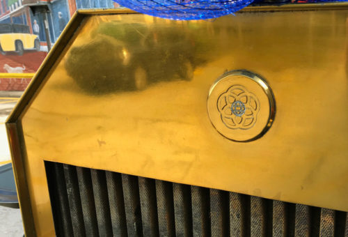 The original Epcot Center logo on the grill of the double-decker bus