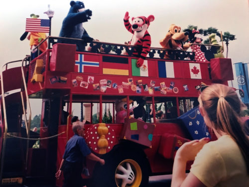 Characters on Holiday double-decker bus at Epcot World Showcase