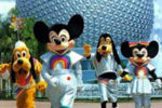 Mickey, Minnie, Pluto, and Goofy in rainbow suits at EPCOT Center