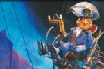 Dreamfinder aboard the Dream Machine in Journey Into Imagination